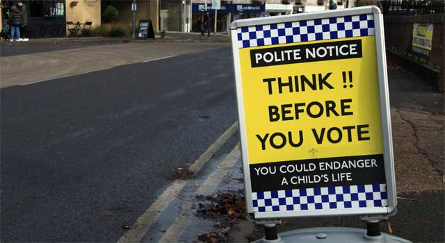 think before you vote sign